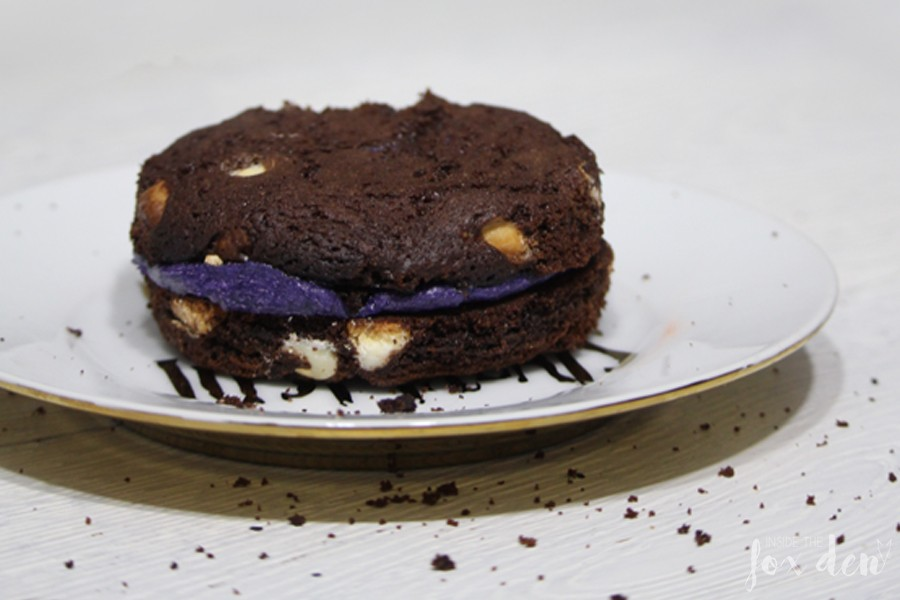 Dark chocolate cookie sandwich with purple filling