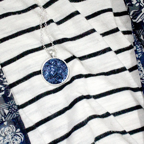 Blue faux druzy necklace on striped shirt