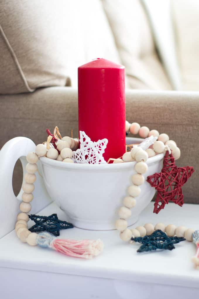 Wood bead garland with stars in candle vignette