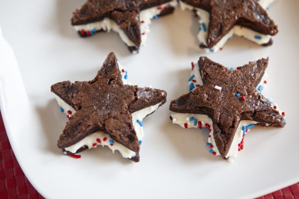 Star brownie sandwiches on plate
