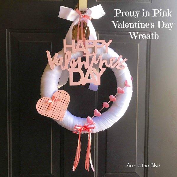 Happy Valentine's Day wreath hanging on door
