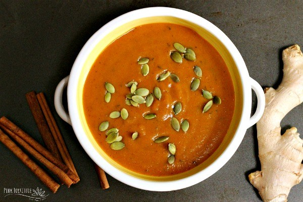 Bowl of pumpkin bisque topped with pumpkin seeds