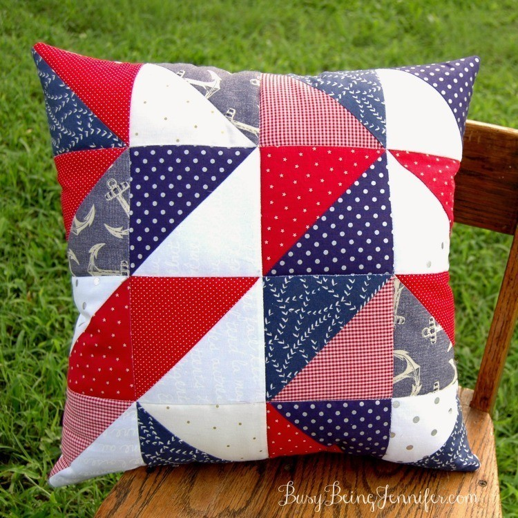 Red, white, and blue quilted pillow on chair