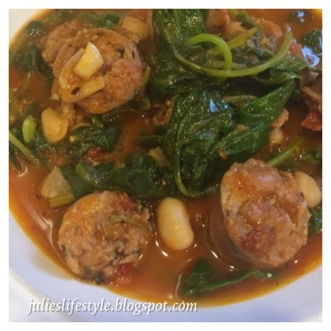Close up of bowl of sausage meatballs and kale soup
