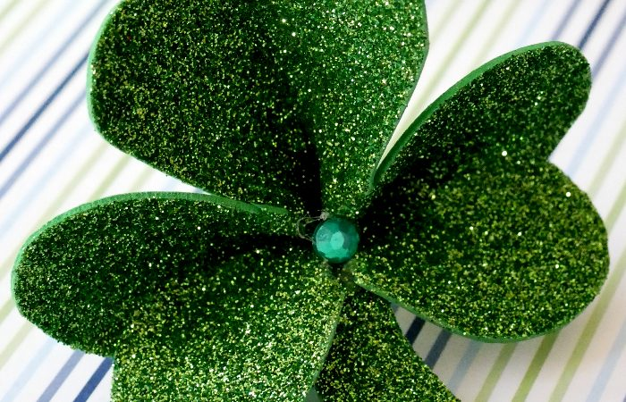 Close up of glittery shamrock pin