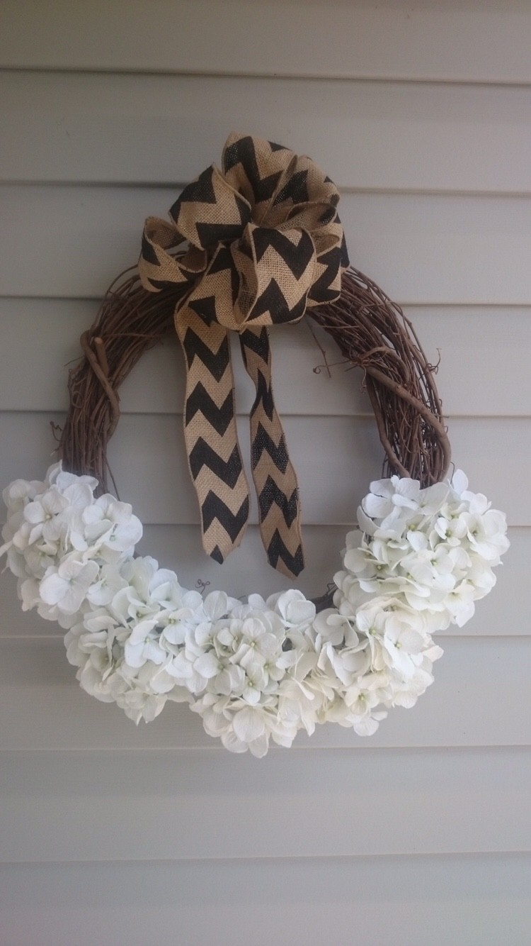 Grapevine wreath with white flowers and burlap ribbon