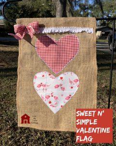 Burlap garden flag with hearts on it