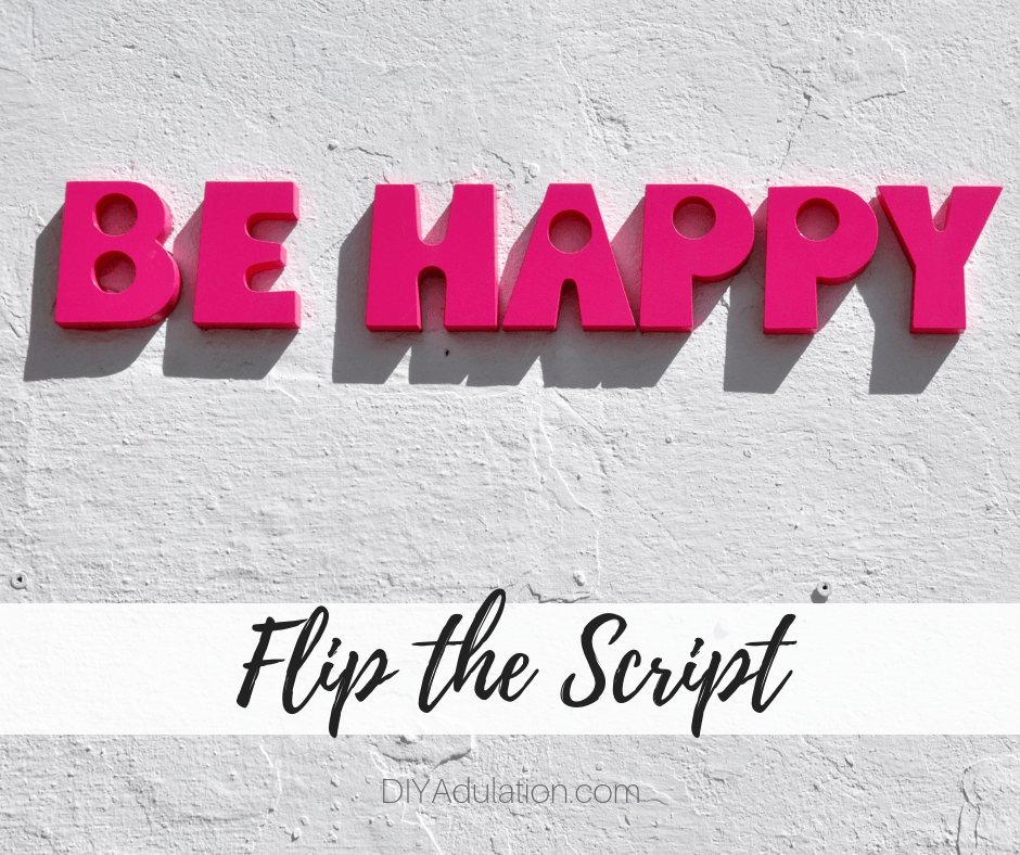 Be Happy Sign on White Wall with text overlay - Flip the Script