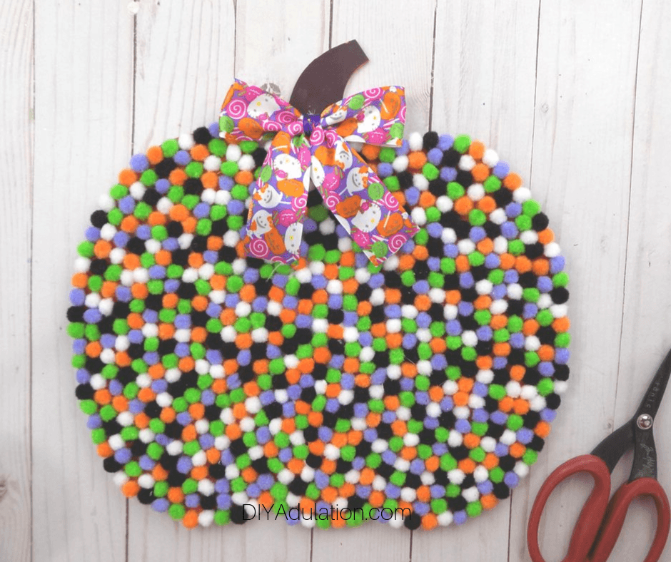 Bow Glued to top of Pompom Pumpkin