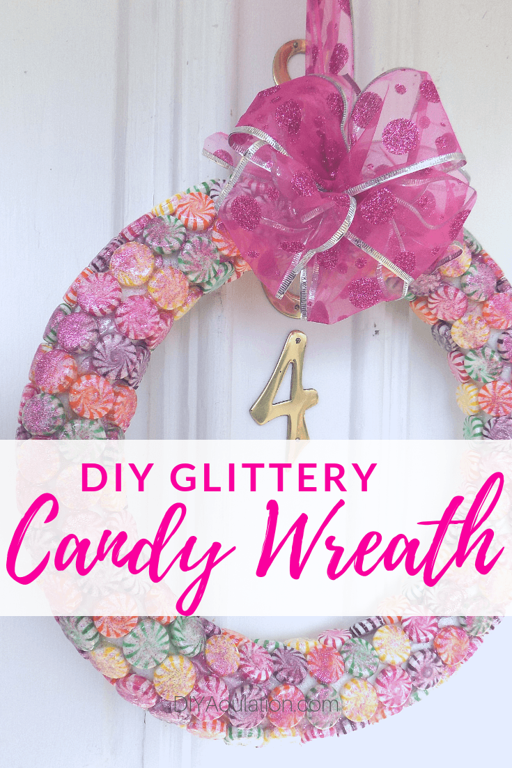 Candy Wreath Hanging on Door with text overlay - DIY Glittery Candy Wreath