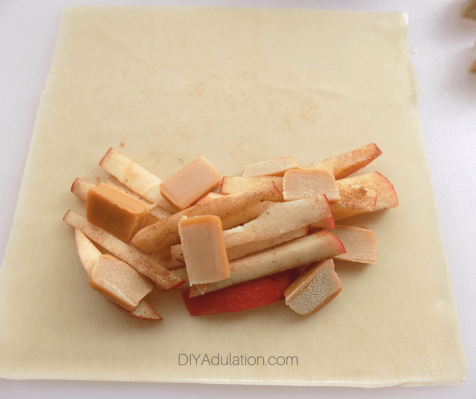 Caramel Pieces and Apple Sticks on Egg Roll Wrapper