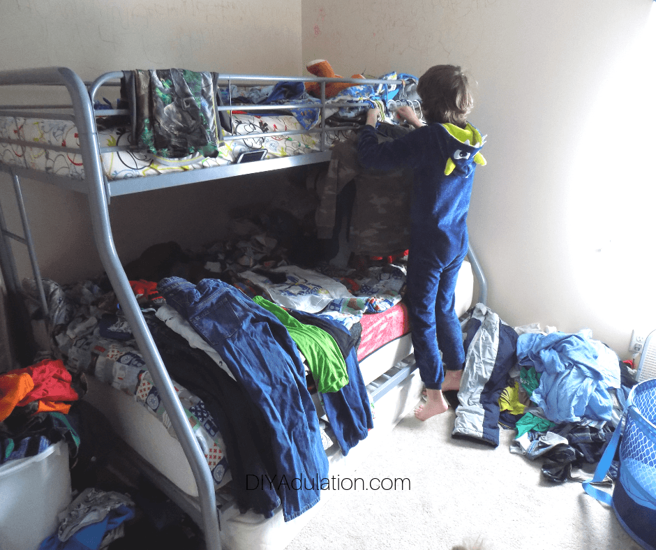 Child Sorting Through Clothes in Bedroom