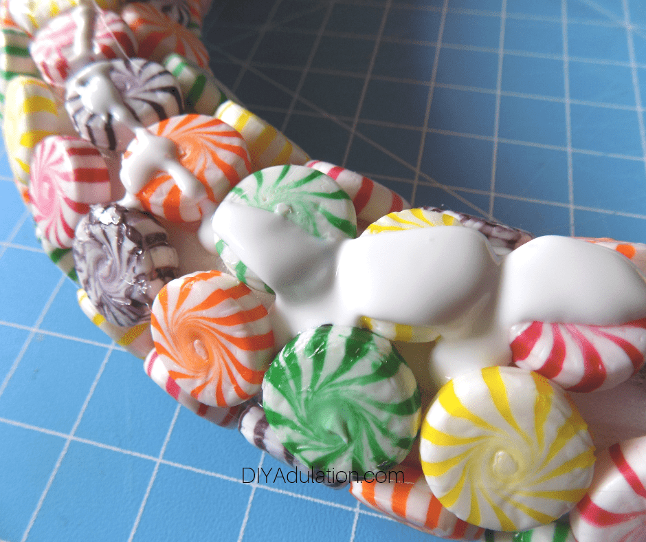 Close Up of Candy Wreath with Mod Podge on It