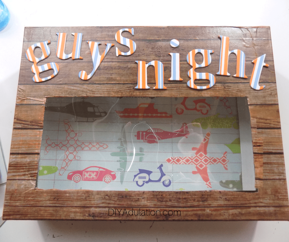 Close Up of Guys Night Letter Attached to Box