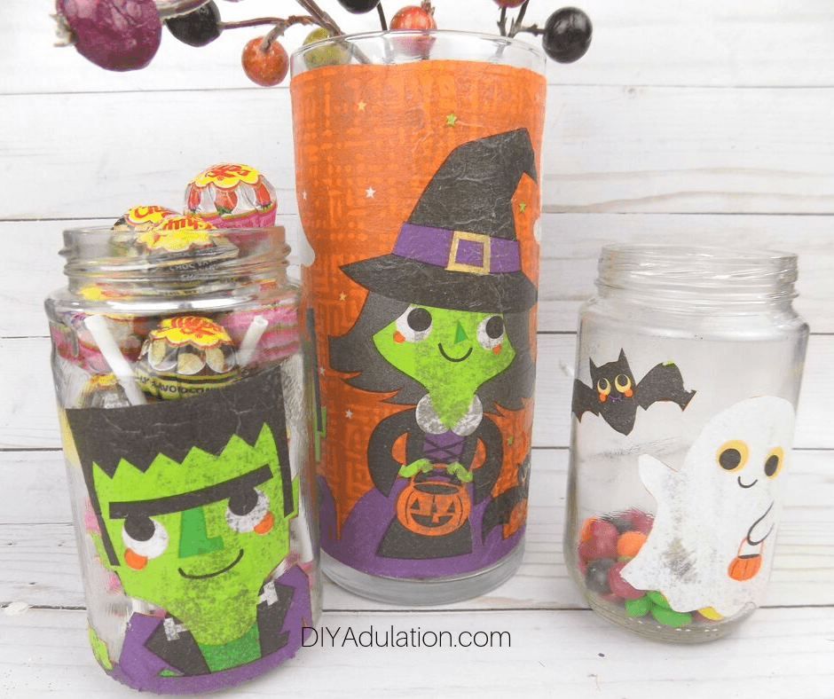 Close Up of Halloween Jars on Wood Background