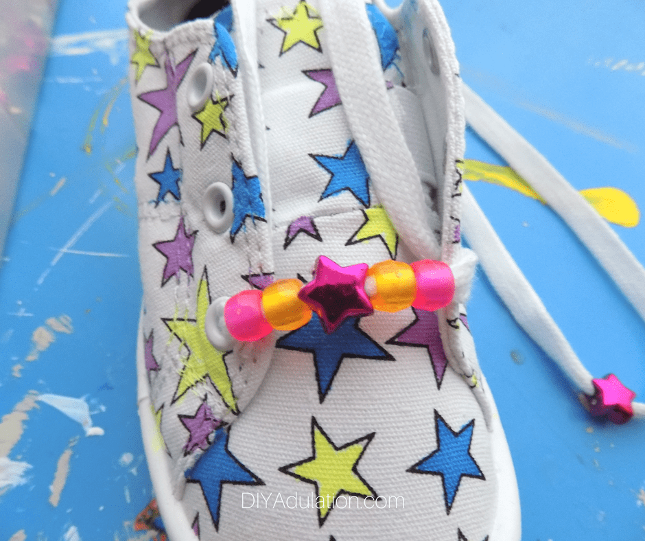 Close up of Beaded Laces on Colorful Star Shoes