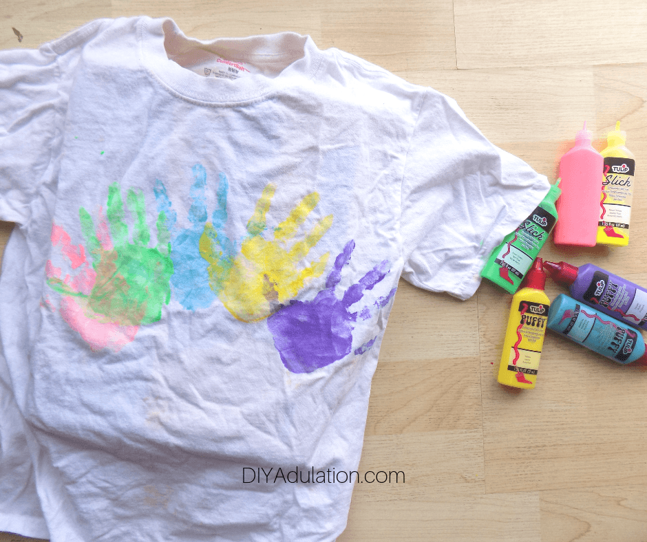 Colorful Hand Prints on White T-Shirt