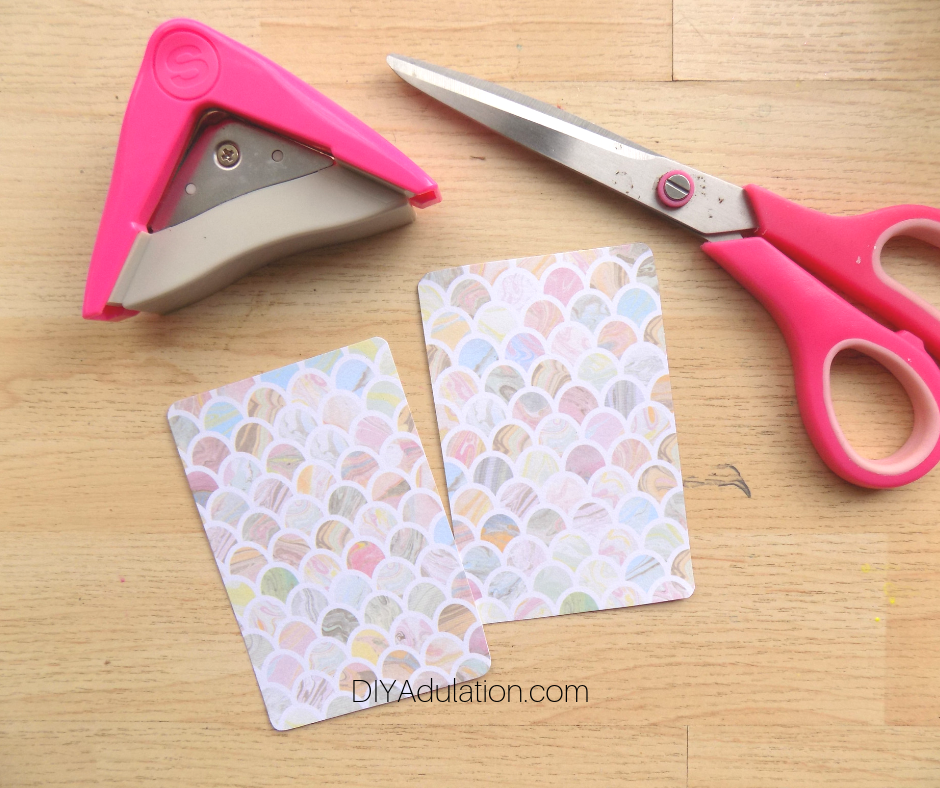 Corner Rounder and Scissors Next to Pastel Cards