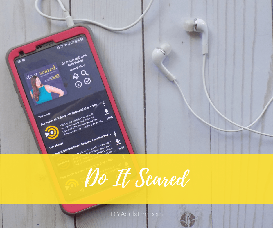 Do It Scared Podcast on Phone Next to Headphones