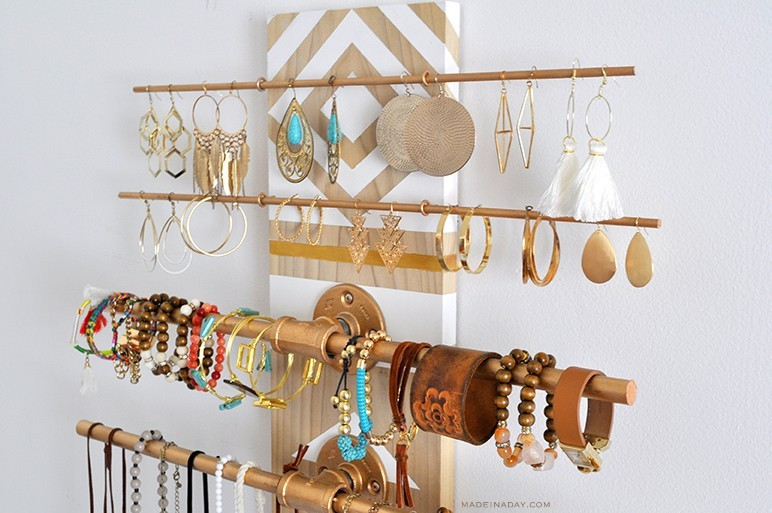 Close up of gold and wood jewelry organizer