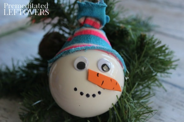 Snowman ornament hanging on tree