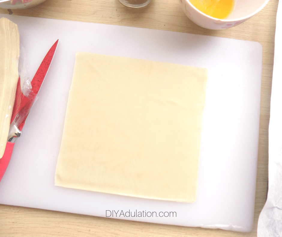 Egg Roll Wrapper on Cutting Board next to Knife