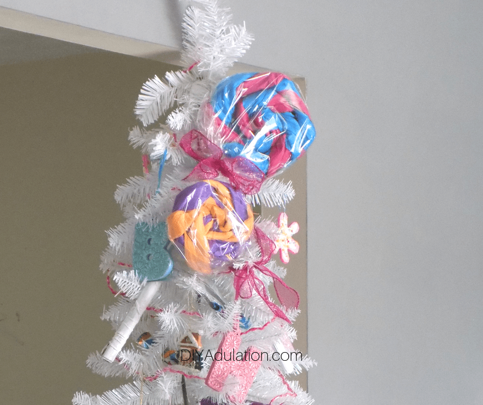 Giant Lollipops on Top of White Christmas Tree