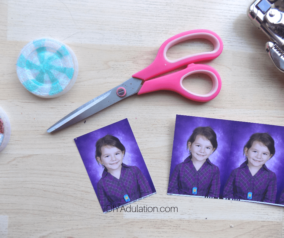 Girls Picture Cut from Additional Photos Next to Scissors