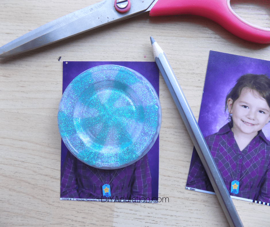 Glitter Candy Lid on Girls Photo next to Pencil