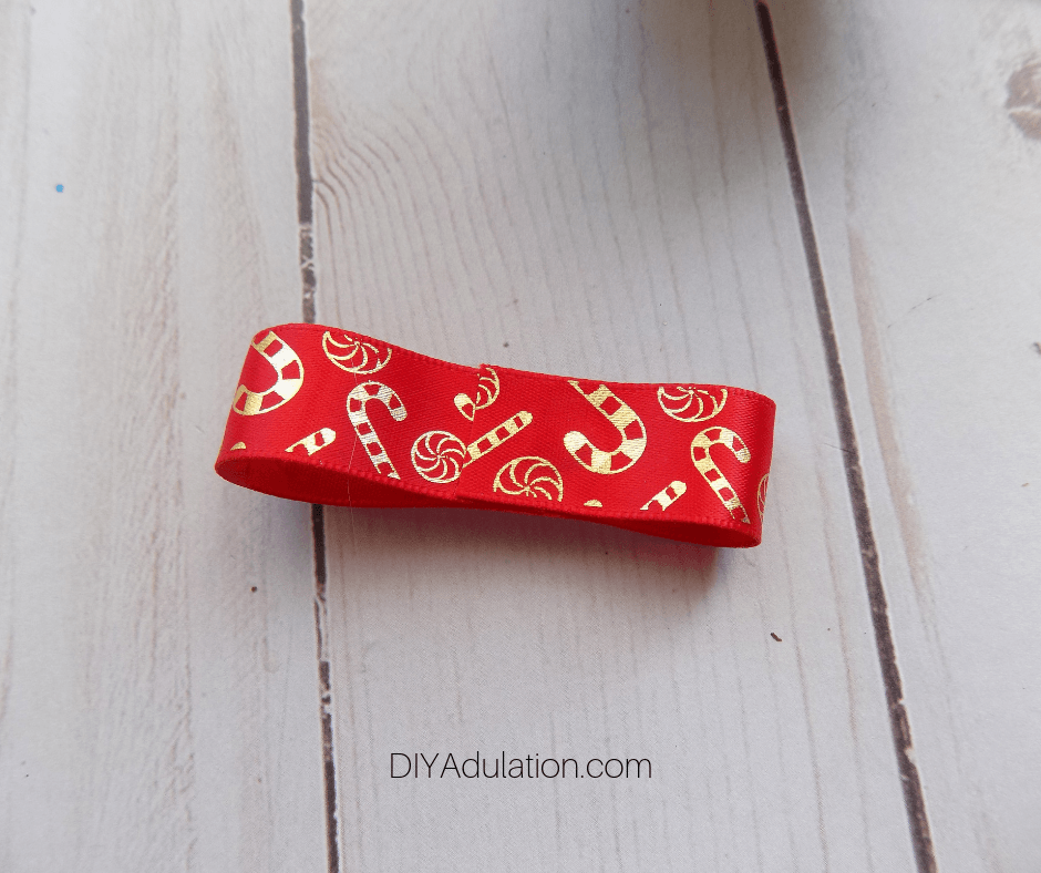 Glued Piece of Red and Gold Candy Cane Ribbon