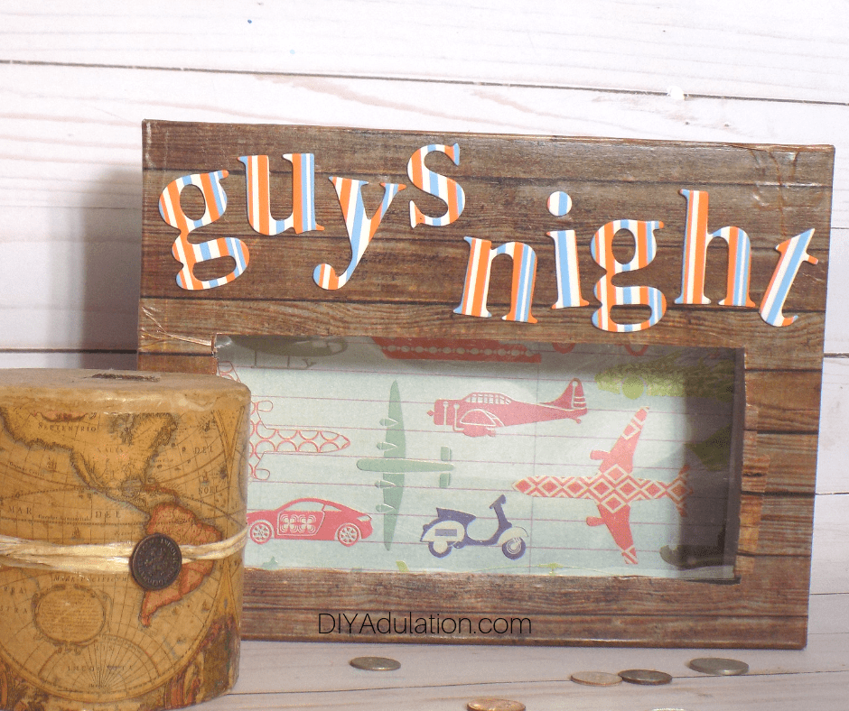 Guys Night DIY Bank next to Map Candle