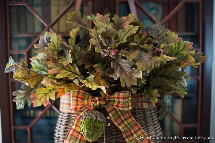 Autumn floral arrangement in basket hanging on a door
