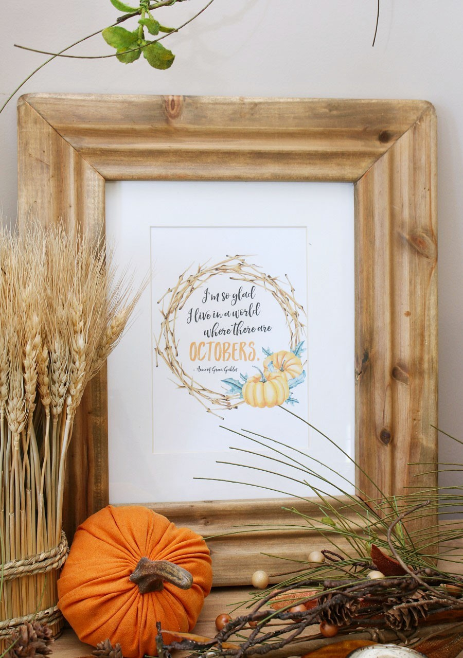 Framed Fall Printable next to mini pumpkin and wheat