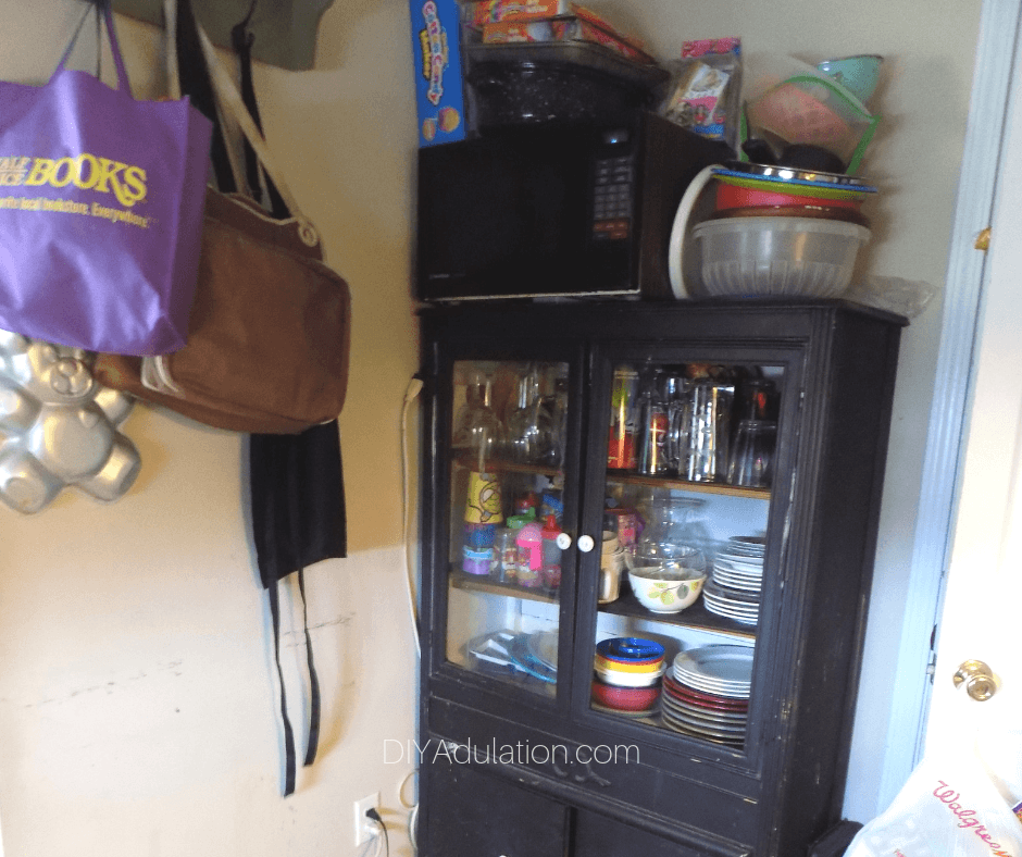 Overflowing China Cabinet in Kitchen