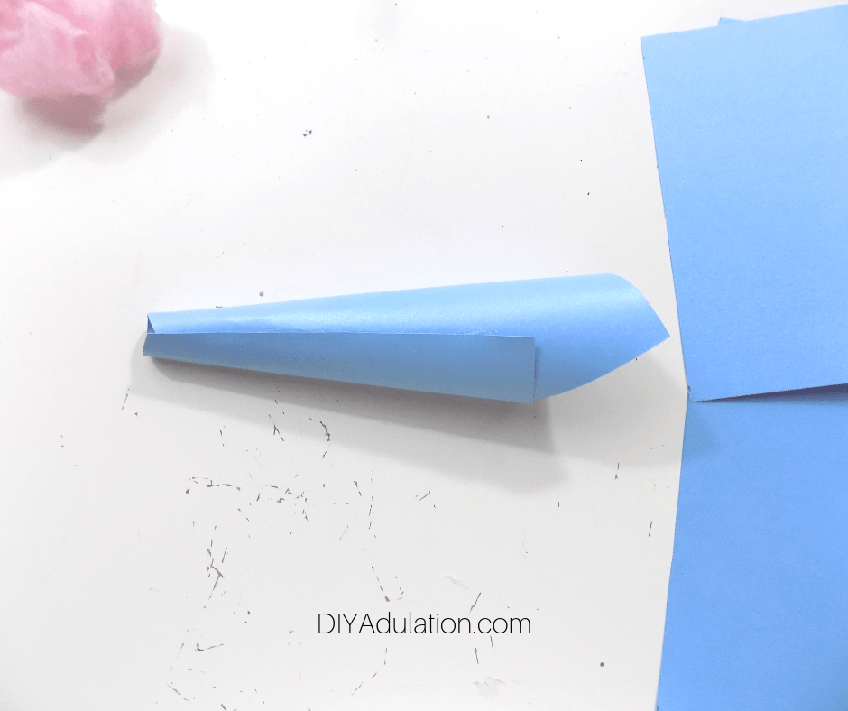 Paper Cone Next to Blue Paper