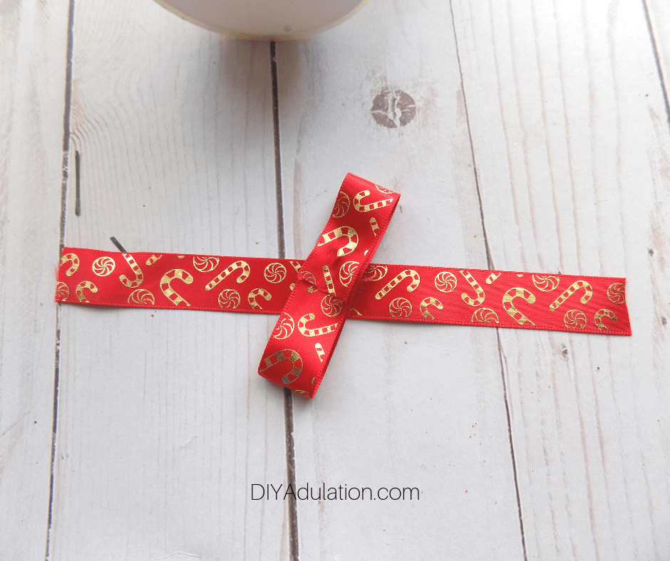 Pieces of Red and Gold Candy Cane Ribbon