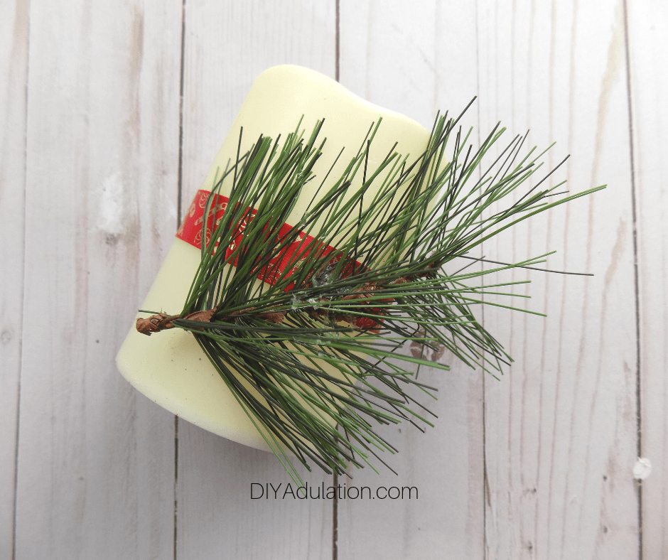 Pine Sprig Glued to LED Pillar Candle