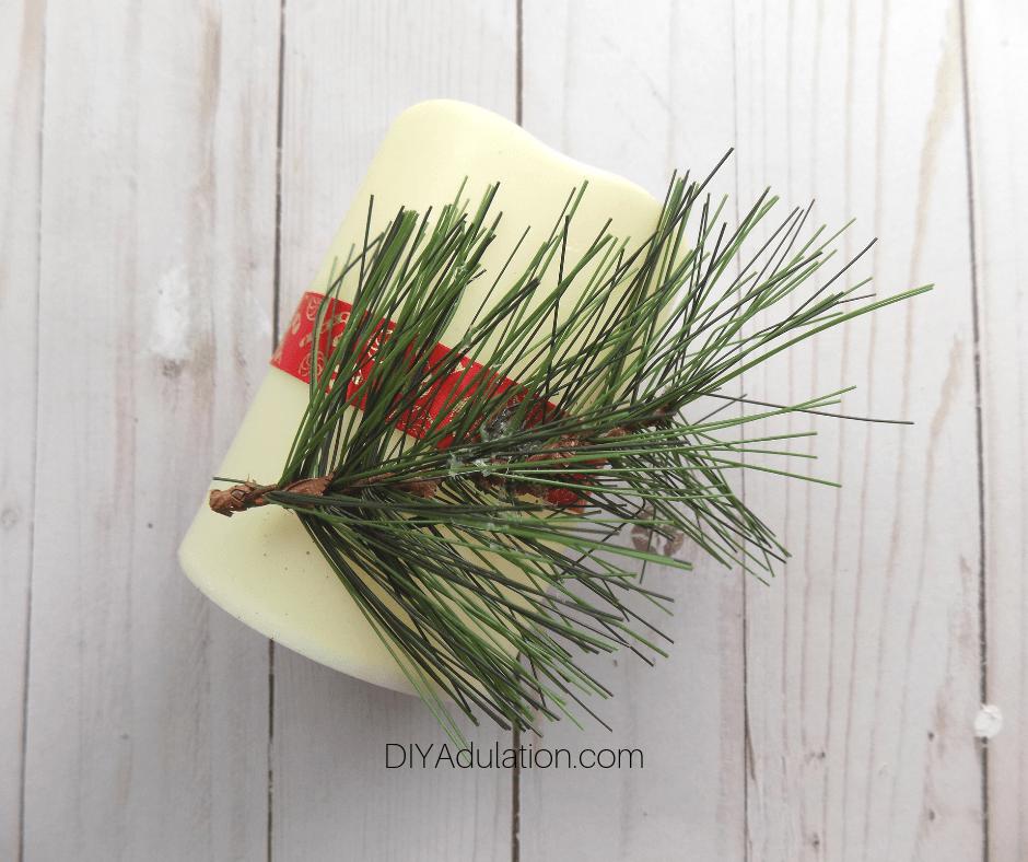 Pine Sprig Glued to LED Pillar Candle