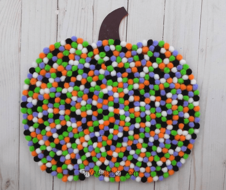 Pompom Covered Pumpkin Sign