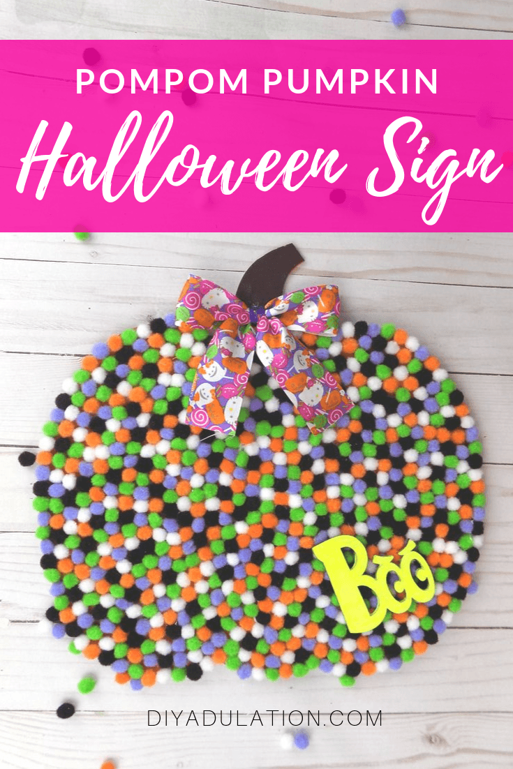 Pompom Pumpkin with bow with text overlay - Pompom Pumpkin Halloween Sign