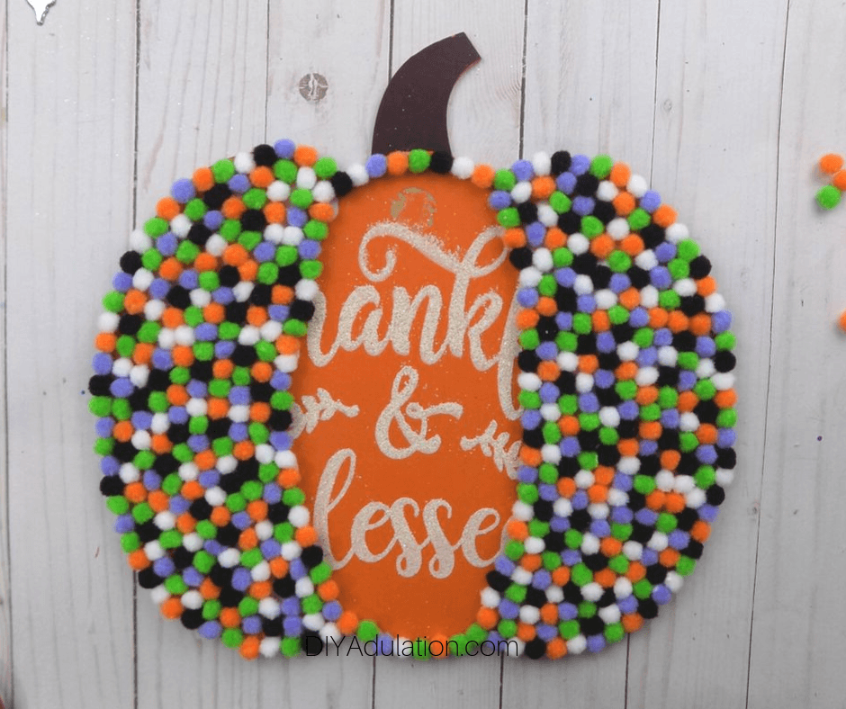Pompoms on Two-Thirds of Pumpkin Sign
