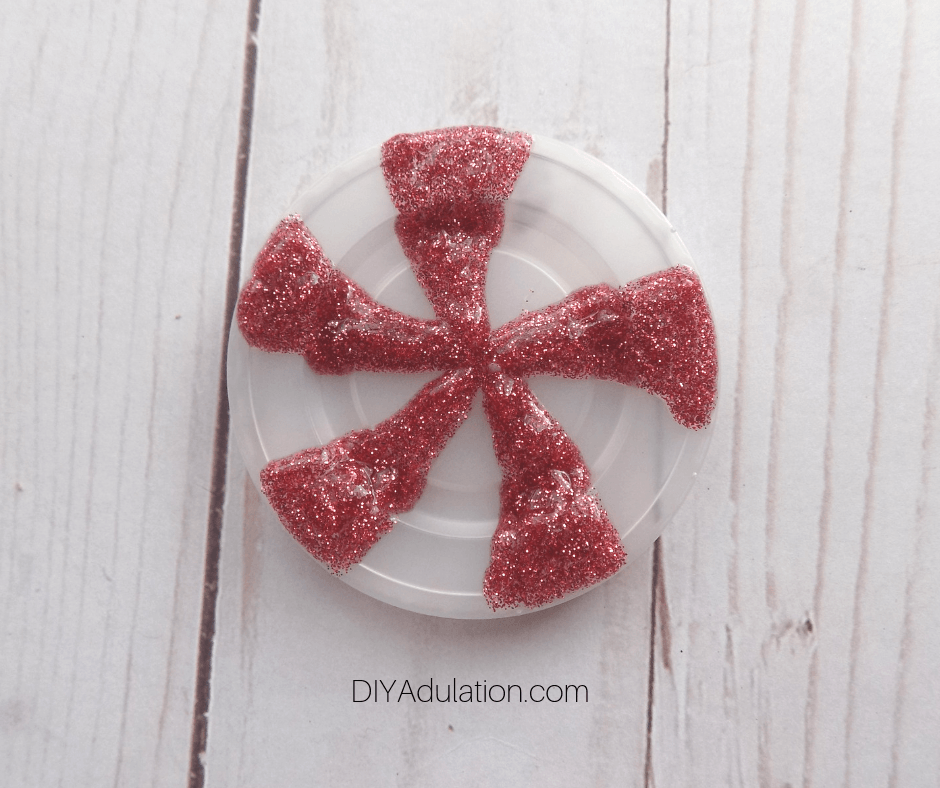 Red Glitter Glue on Condiment Container Lid