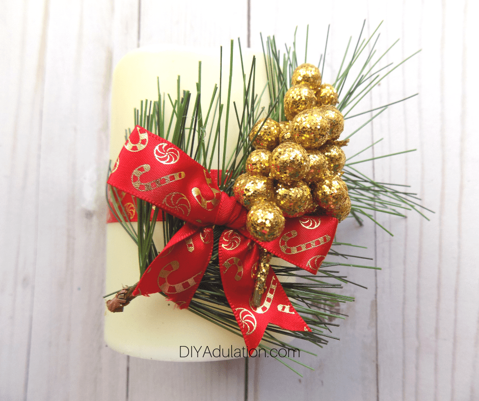 Red and Gold Candy Cane Ribbon Bow Glued on Candle