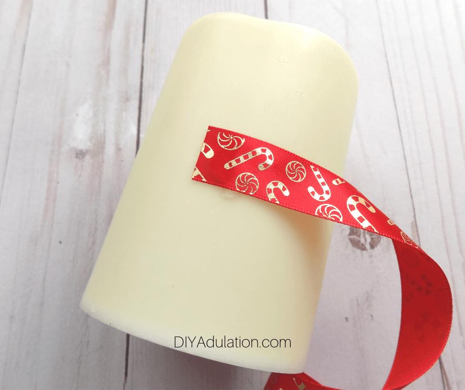Ribbon End Glued to LED Pillar Candle