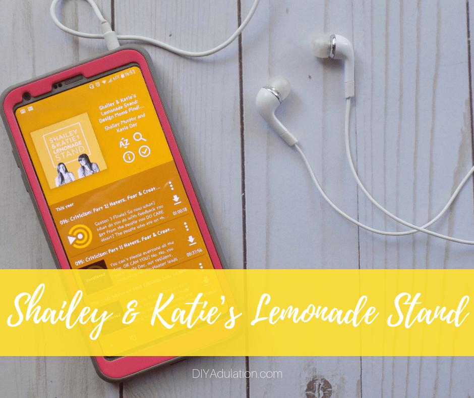 Shailey Katies Lemonade Stand Podcast on Phone Next to Headphones