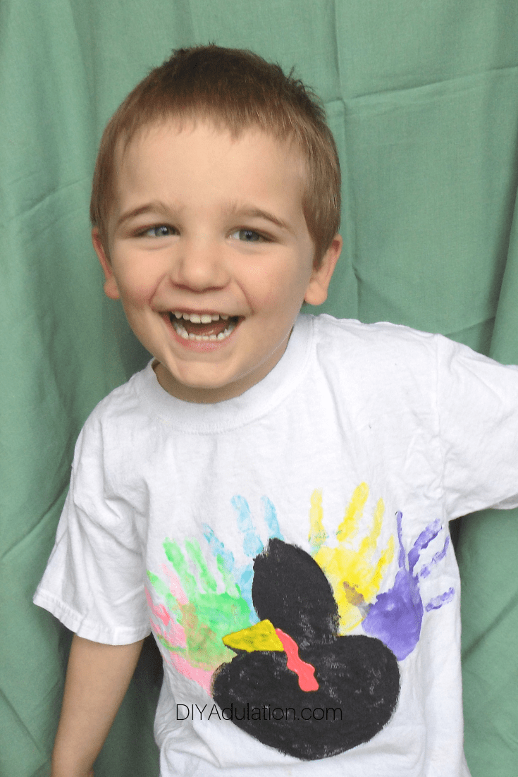 Smiling Boy Wearing a Hand Print Turkey Shirt