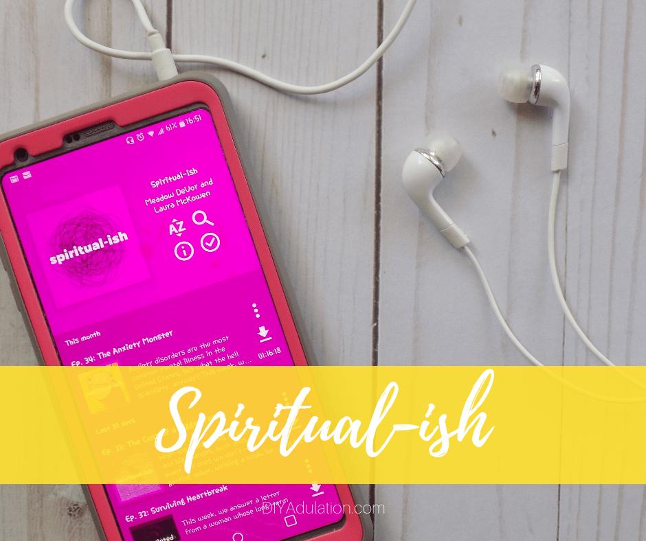 Spiritualish Podcast on Phone Next to Headphones