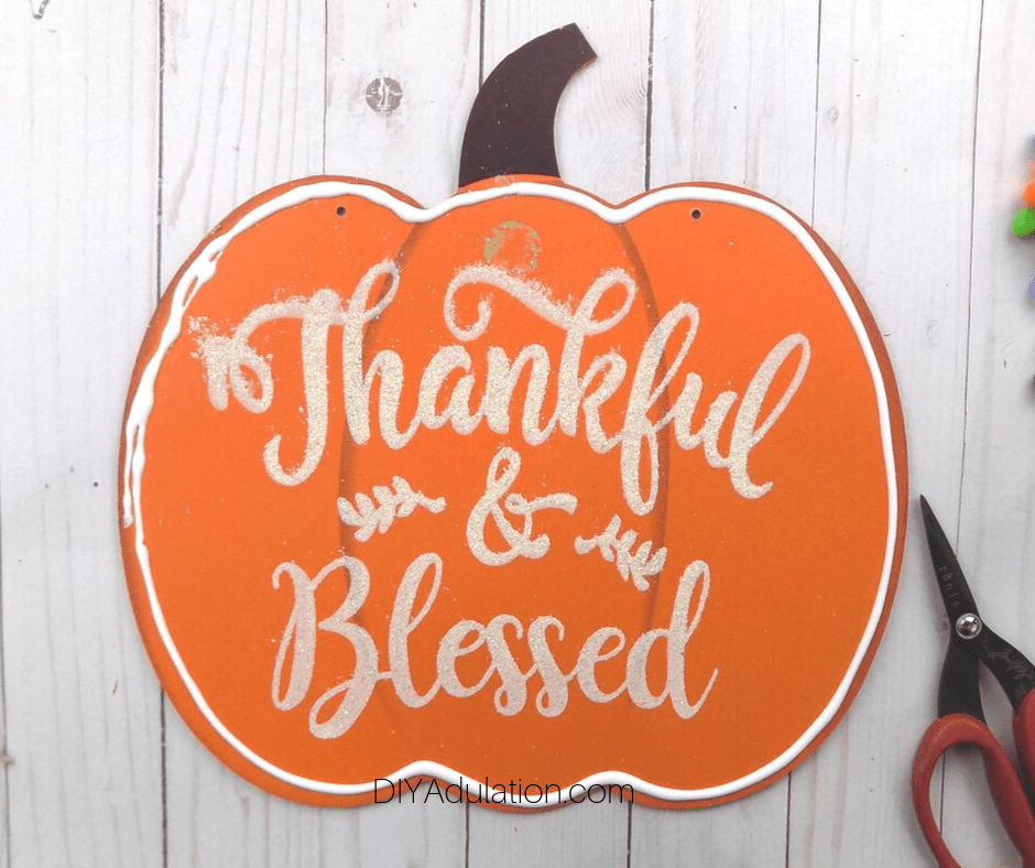 Thankful and Blessed Wooden Pumpkin Sign with Glue Around the Edge