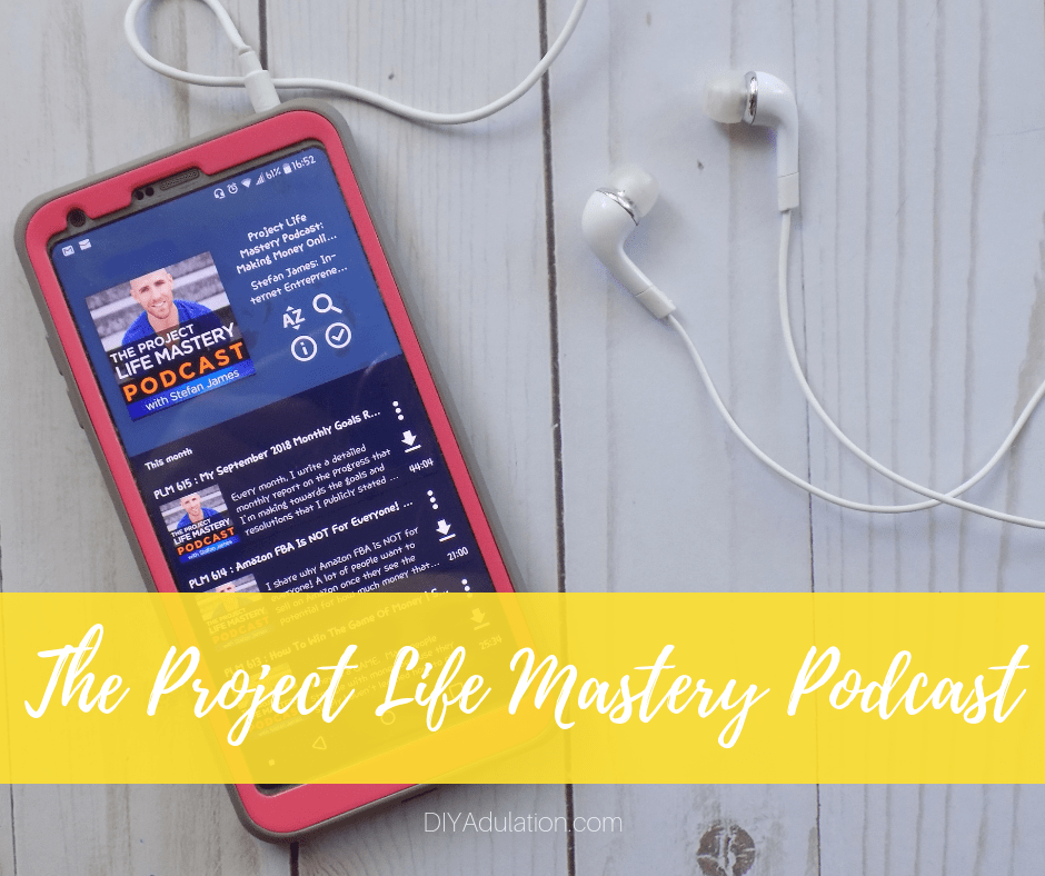 The Project Life Mastery Podcast on Phone Next to Headphones