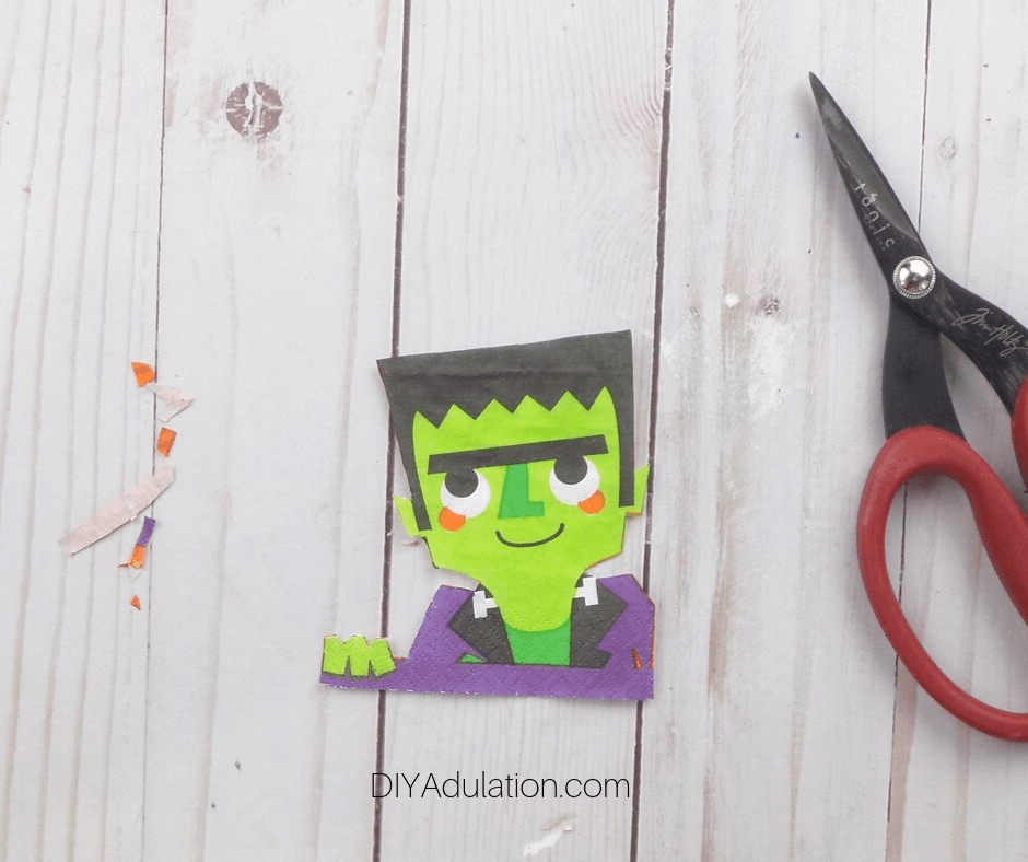 Trimmed Frankenstein Cutout Next to Scraps and Scissors